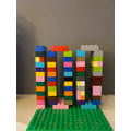 Poppy (4M) & her mum have done 100 star jumps and made the model from 100 pieces of Lego.