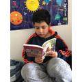 Santi enjoying a book!