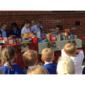 Year 2 children receive the kind donations from each child in the school