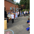 Each child offered their donations to the Harvest table