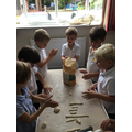 Making bread to donate to St John the Baptist Church