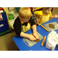 Rolling and cutting out our gingerbread people.