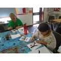 We used black paint and a brush to draw the kanji.