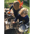 enjoying the mud kitchen