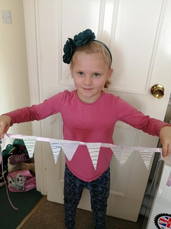 Rosie in Beech Class with her VE Day Bunting.jpg