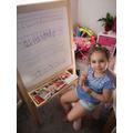 Amira (Robins) practising writing.
