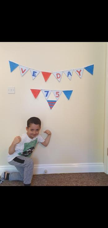 Ruzgar  in Beech Class made celebratory VE Day bunting.jpg