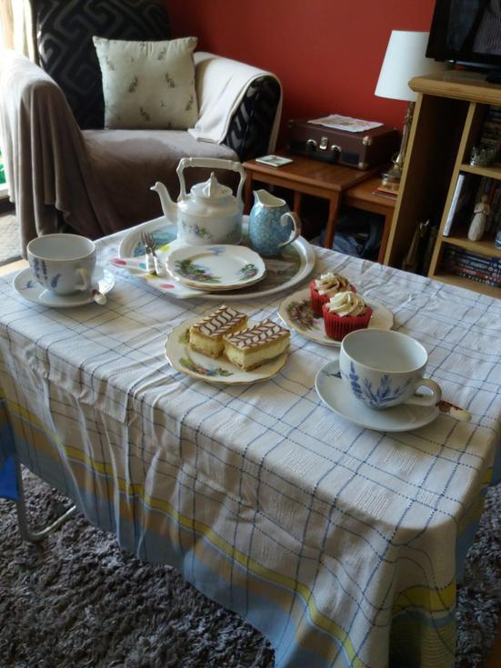 Mrs Cox enjoys a custard slice with her tea.jpg
