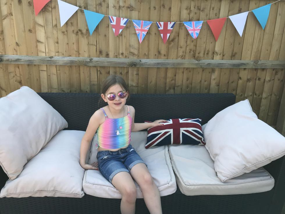 Ella (Pine) with her homemade VE day bunting