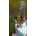Jennifer watching the ducklings on her daily walk.jpg
