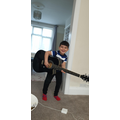 Miran (Swallows) learning guitar.jpg