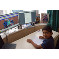 Ranvijay (Willows) set up for his homelearning with the school website in the background..JPG