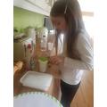 Emily (Pine) making her potion.jpg