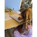 Lily (Badgers) practising her spellings.jpeg