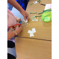 Cutting out shapes from paper we've coloured