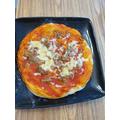 Karim (Pine) has made a pizza.