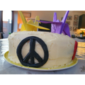 """""""I used coloured icing and made a love heart, olive branch, peace symbol & happy emoji"""""""