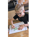 Henry doing some Maths work at home Well done!