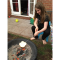 Jessica toasting marshmallows