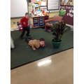 Acting out the story of the Enormous Turnip.