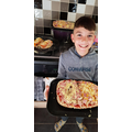 Oliver making pizza to go towards his cub badge!