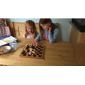 Izabella playing Draughts with her sister!