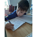 Finely working hard on his handwriting