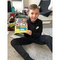 Ethan enjoying his new book!
