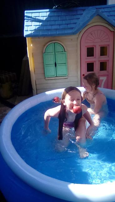 Isaebella apple bobbing in the pool...