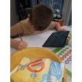 Jimi working really hard on his home-learning. Well done!
