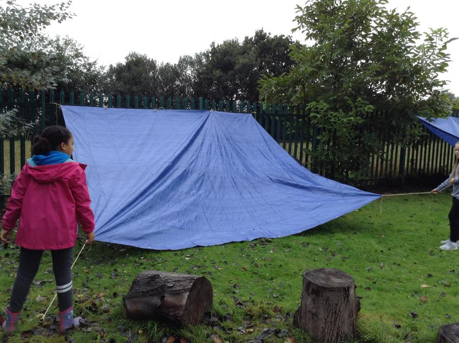 Den building to protect us from that rain.