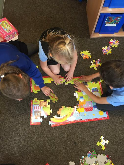 We work together to complete puzzles.