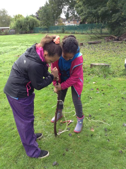 Girls working together to make a peg!