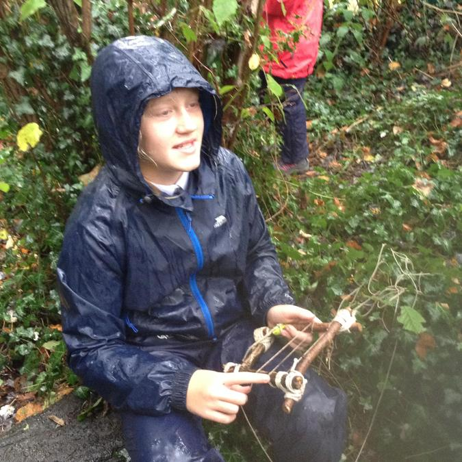 Embracing the rain whilst weaving.