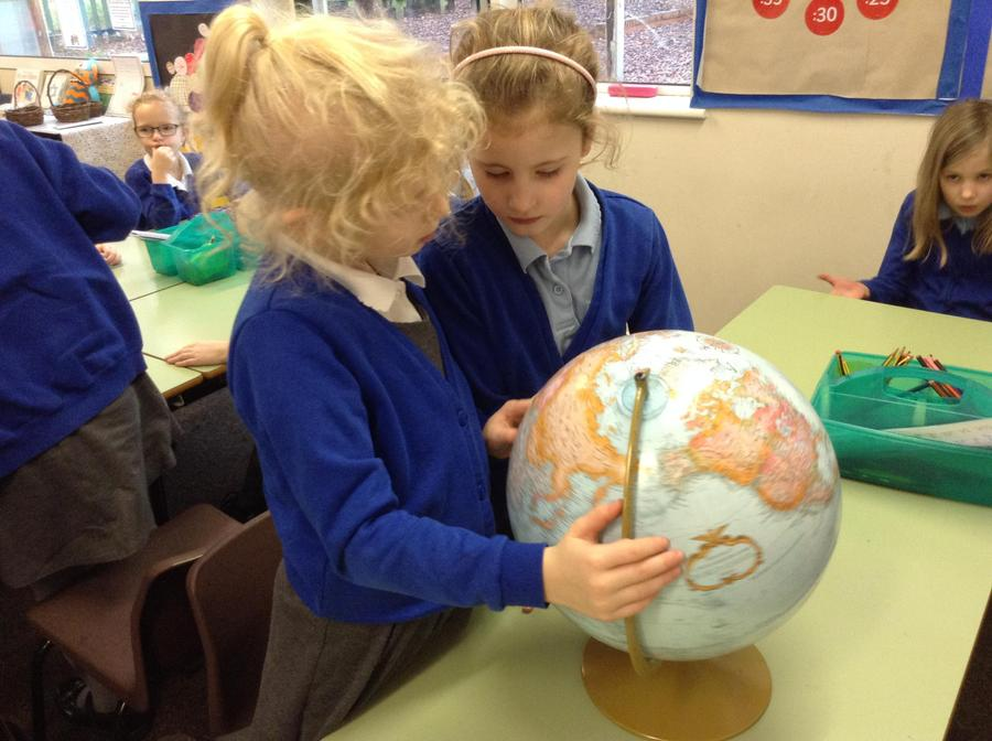 Discussing the size and location of continents.