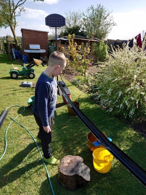 Zak making water travel down the garden