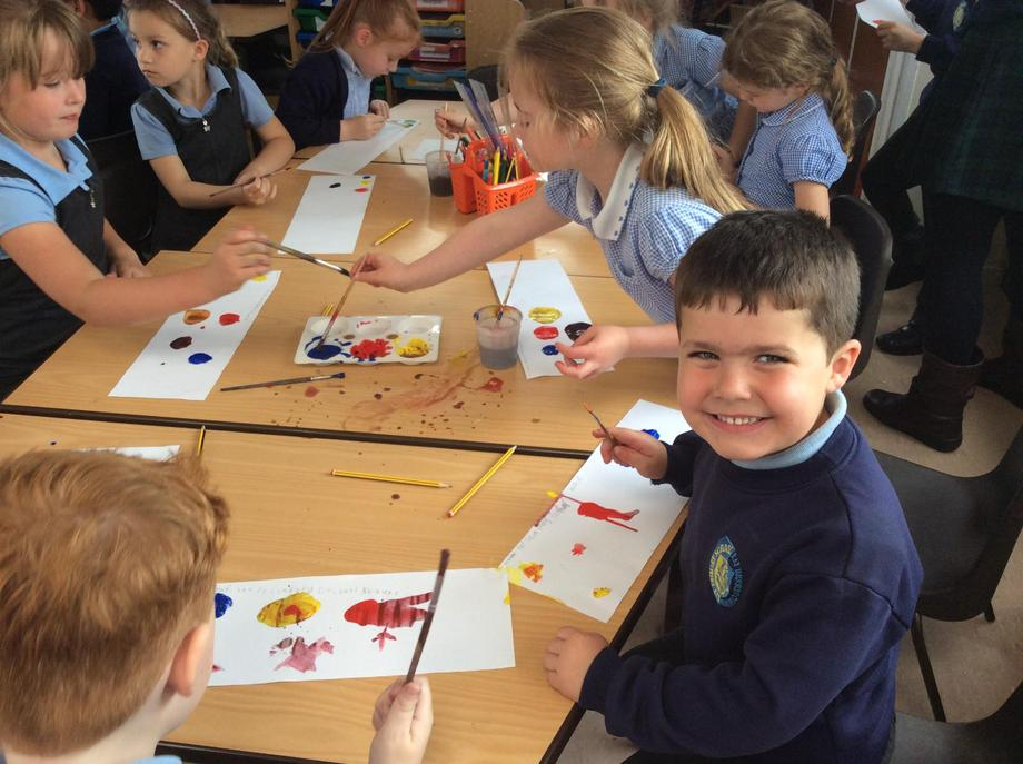 Exploring colour mixing with 3 primary colours.