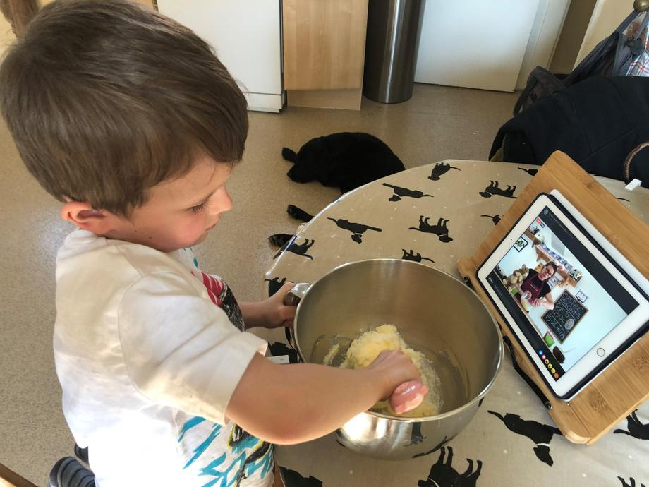 Cooking at home following a video tutorial