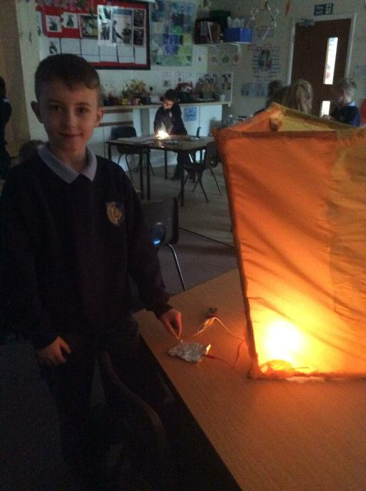 The children also made the light bulbs light up by creating a circuit and using foil as a switch.