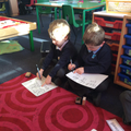 Using phonics to spell new words.