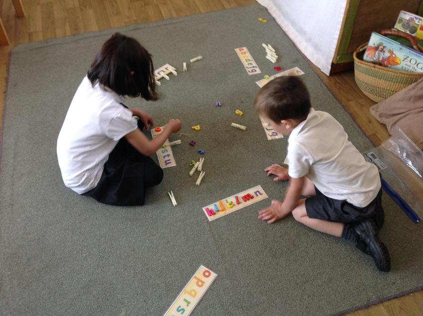 Matching letters , saying the phoneme and names of the letters.