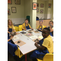 Year 4 making their clay sculptures