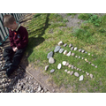 Lining up stones to make a pattern