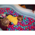 Trying to swim in the ball pool