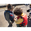 Helping each other into their life jackets