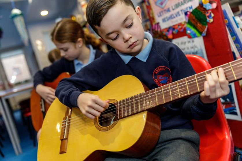 'I do guitar lessons in school every week with a real musician!'