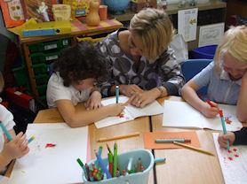 Mrs Lobo lending a hand in Class 1.