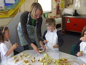 Mrs Bartlett making some toffee apples with Class 1. Yum!