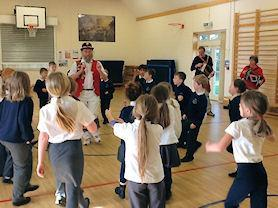 Learning how to Morris Dance.