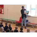 Author Grant Koper reading to the children.